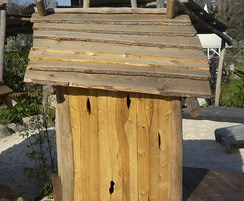 Play hut with waveny roof