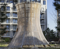 Play structure made with curved glulam beams