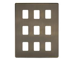 Antique brass screwless 9-gang grid plate