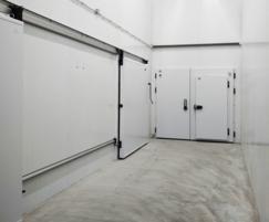 Automated sliding refrigeration door