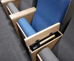 A foldaway tablet is stored in the Caspian's armrest