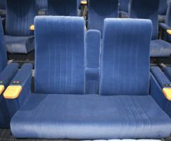 Cinema seats with drinks table armrest