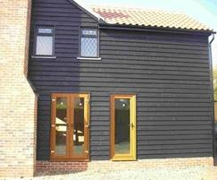 Q-Clad® pre-painted, black feather edge timber cladding