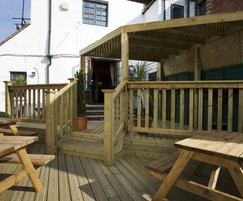 Slip resistant decking for outdoor dining area at pub