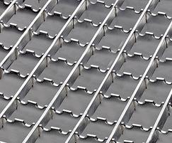 Serrated non-slip stainless steel gratings