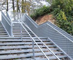 Structural balustrade and  33x11mm mesh stair tread