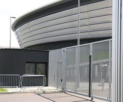 Entrance gates provide security at concert venue