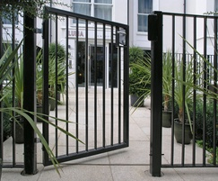 Single leaf pedestrian gate matches railing fence