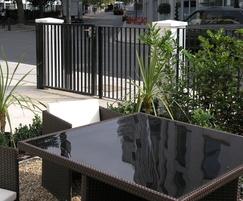 Rimini fencing panels installed between brick pillars