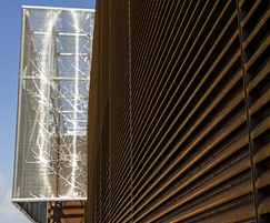 Corten louvres contrasting with etched stainless steel