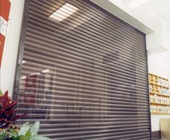 Electrically operated perforated lath roller shutter