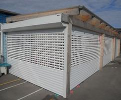 Electrically operated punched lath roller shutters