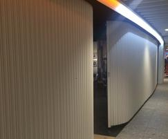 Curved shutters protect shop at Newcastle Airport