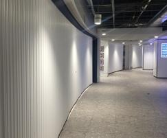 Curved security shutters at airport duty free