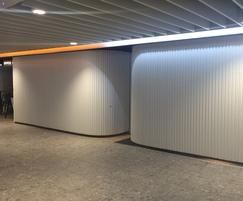 Curved shopfront shutters at Newcastle Airport