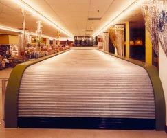 Fire-resistant roller shutter for escalators