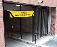 Bi-folding security entrance gates
