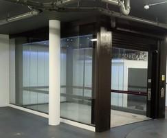 Entrance secured with roller shutter