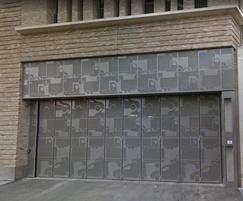 Bespoke folding security doors with vehicle motif
