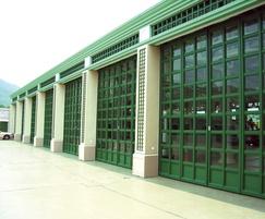 Folding doors with glazed panels
