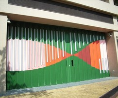 Colourful folding shutter doors at fire station