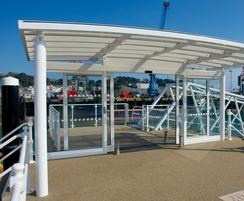 Structural mild steel framework with toughened glass