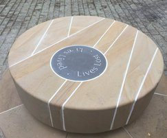 Stone seat with integral flecks of coal