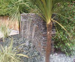 Grey quartz paddlestone water feature