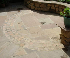 Slabby sandstone paving  shown with setts