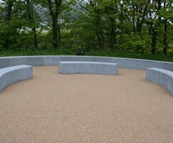 Solid curved sinuous benches for skate park