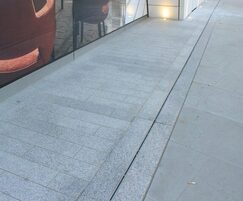Silver grey granite setts with linear channel drains