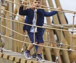 Boys running across wobble bridge @ Crannog
