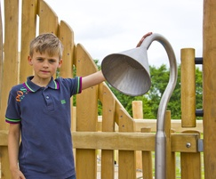 Boy posing with inclusive Talk Tubes at Crannog