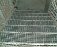 Type SP landing and stair treads with non-slip inserts