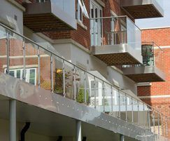Structural glass balustrades with stainless steel