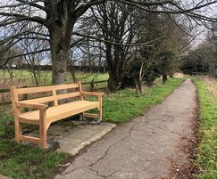Greenwich wooden seat on country path, Wiltshire