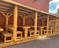 School outdoor shelter with seating and tables
