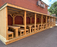 14.4m-long timber shelter with 8 bays