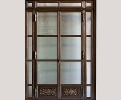 Bronze door with glass panels