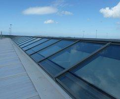 Noise reducing patent glazing system