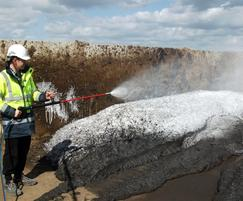 Using the FoamLance to cover a sludge pile