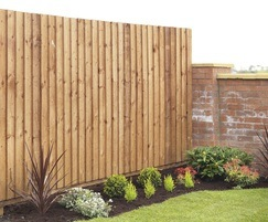 Closeboard timber fencing with cant rail, brown