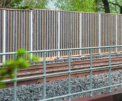 Absorptive timber acoustic barriers for railways