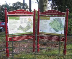 Cavalier entrance signs with cast header and foot board