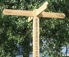 Oak fingerpost with routed detail to post
