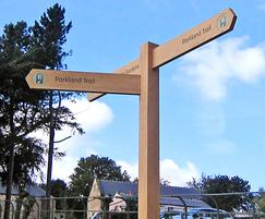 Hardwood fingerpost with inset logo disc