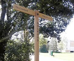 Oak fingerpost with routed logo detail to post