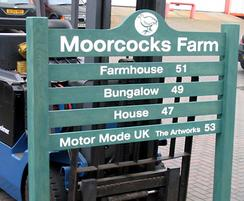 Softwood ladder sign finished in green preservative