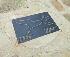 Bronze plaque mounted in ground