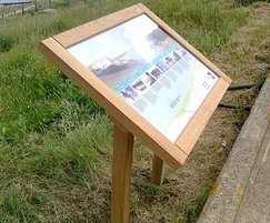 Musketeer timber interpretation panel on seafront